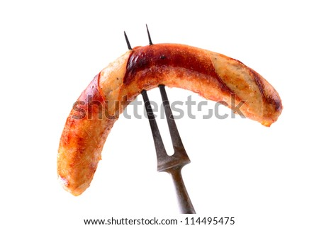 Sausage on fork fresh from grill. Isolated on white.