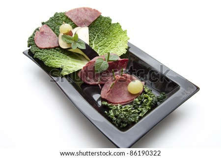 Garnishes For Dinner Plates http://www.shutterstock.com/pic-86190322/stock-photo-sausage-plate-garnishes.html