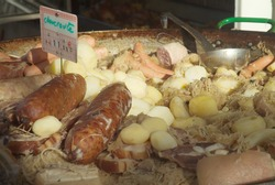 Sausage, sauerkraut and potatoes (choucroute) for sale in french market.  Close-up.