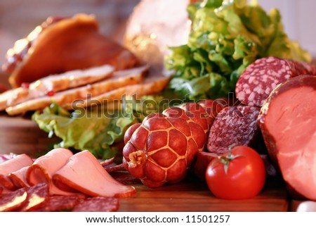 Sausage, tomato  and green salad. Still-life