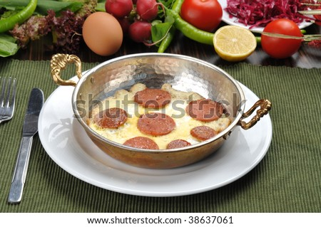 sausage with egg in copper pan turkish meal
