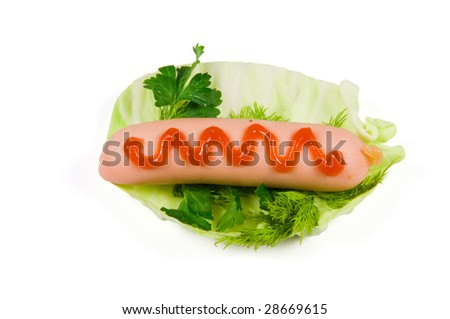 Sausage with ketchup on cabbage sheet on a white background