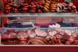 Sausages and meat products for sale in organic food street market, small business, outdoor street sale autumn fair amid coronavirus pandemic lockdown