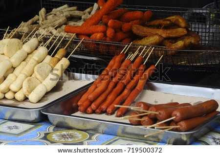 Sausages and some processed foods are pecked with skewers and served.