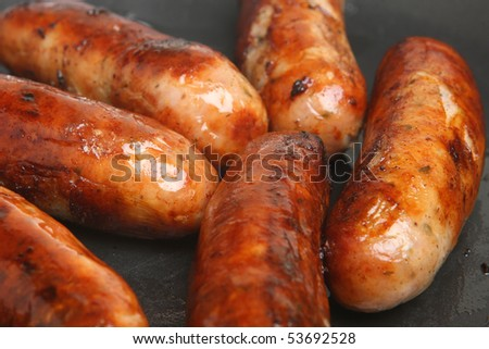 Sausages frying