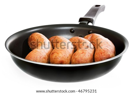 sausages in frying pan isolated on white background