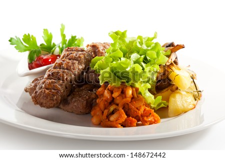 Sausages of Beef, Pork and Lamb Meat. Garnished with Potato and Green Salad Leaf