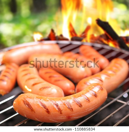 sausages on a grill. in the...