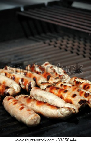 Sausages sizzling on a bbq grill - stock photo