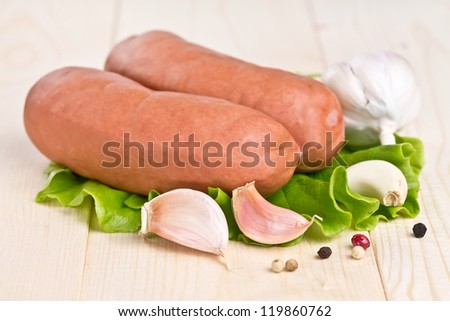 sausages with garlic and parsley on lettuce leaves