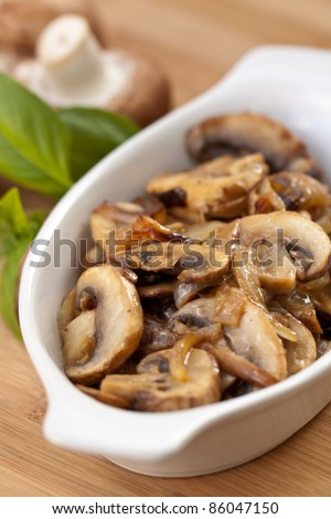 Sauteed mushrooms. Sauteed mushrooms and yellow onions. Macro.