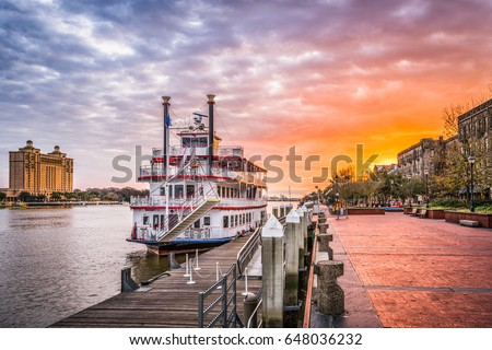 Savannah, Georgia, USA riverfront promenade at sunrise.