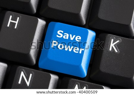 save power or energy concept with key on computer keyboard