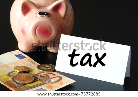 save tax concept with piggy bank and money on black