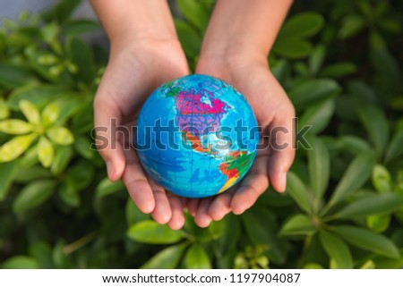 Save the earth concept, Woman hands is holding mockup the global on tree leave background. #1197904087