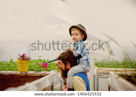 save the earth. father and son try save the earth. save the earth concept. save the earth with your family #1406421932