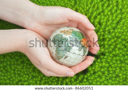 Save the World. Globe in green moss.