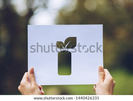 save world ecology concept environmental conservation with hands holding cut out paper leaves battery saving energy showing #1440426335