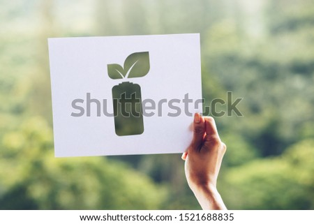 save world ecology concept environmental conservation with hands holding cut out paper leaves battery saving energy showing #1521688835