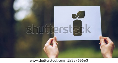 save world ecology concept environmental conservation with hands holding cut out paper leaves battery saving energy showing #1535766563
