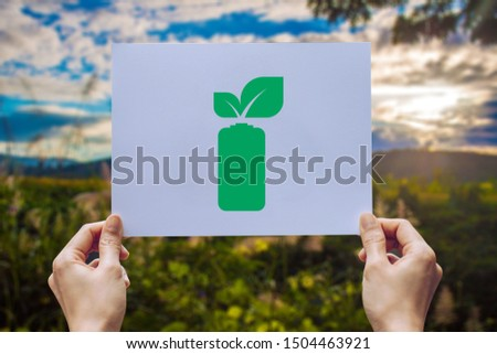 save world ecology concept environmental conservation with hands holding leaves battery saving energy showing #1504463921