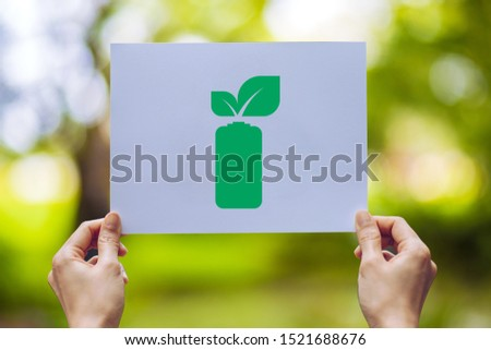 save world ecology concept environmental conservation with hands holding leaves battery saving energy showing #1521688676