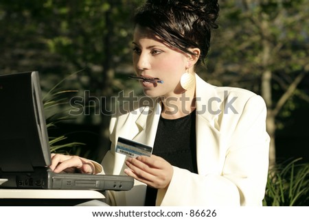 Save your legs girls!  A woman makes an online purchase, online banking,online trading,  billpay