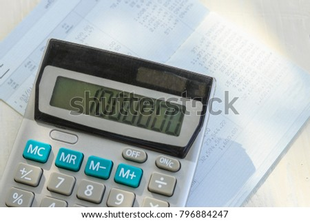Saving account book or financial statement and calculator,Business ...