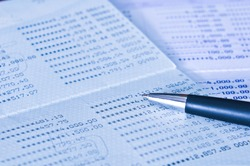 Saving Account Passbook with a Black pen