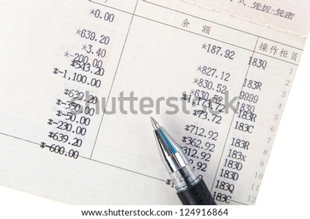 Saving Account Passbook with a Black pen
