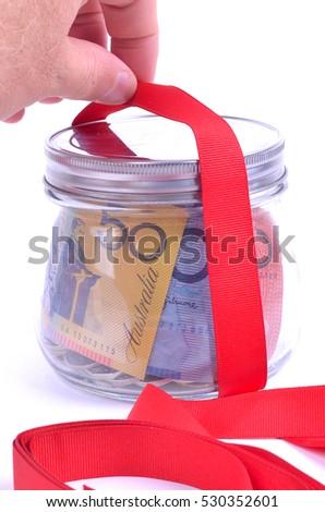 Saving Australian money for Christmas #530352601