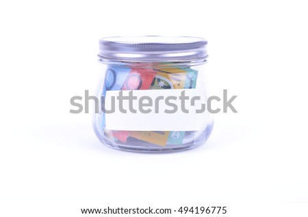 Saving Australian Money in a jar #494196775