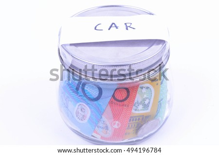 Saving Australian Money in a jar for a new car #494196784
