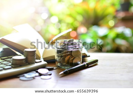 saving coins in bottle for investment concept business and finance