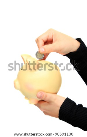 saving euro in a piggy-bank isolated on a white background