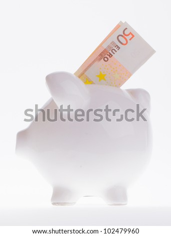 Saving fifty euro in a white money box