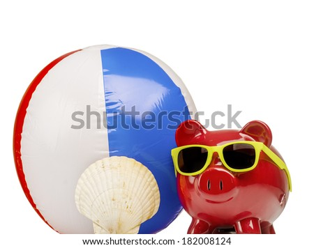 Saving for summer vacation holidays, piggybank,beach ball sunglasses and shell
