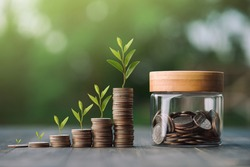 saving money and investment concept. Money coin stack growing graph and coins in jug glass. Balance savings Interest and investment Concept.Business planning and financial management.