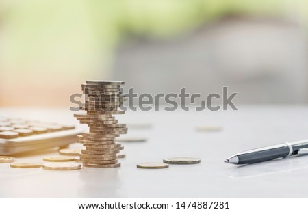 Saving money concept with money coin stack. Stack of coins with copy space for business and accounting concept. #1474887281