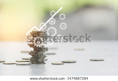 Saving money concept with money coin stack. Stack of coins with copy space for business and accounting concept. #1474887284