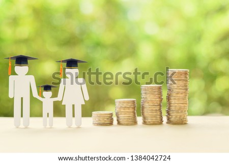 Saving money for kid, child education concept : Family members wear graduation cap or hat, 4 rows of rising coins, depicts increasing in cost or expense for paying tuition fee when study higher class