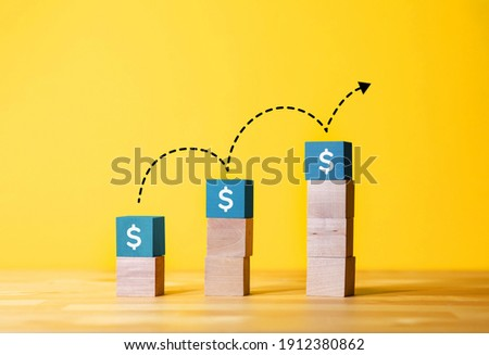 Saving money or profit increase concepts with text on wood blog.financial and investment growth. Stock foto ©