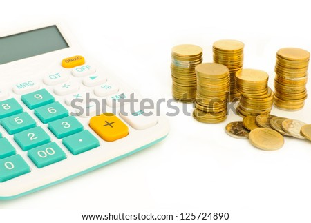 Saving money plan and calculator,stack of coins with white background