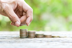 Saving money with stack money coin with copy space for management money, saving, business finance concept.
