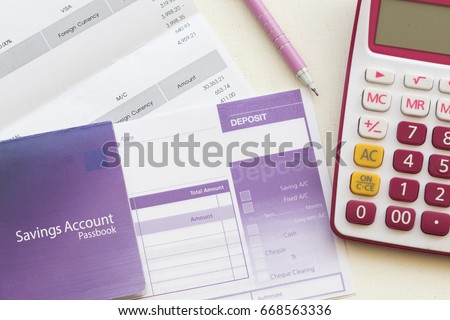 savings account pass book bank and slip deposit for payment expense of credit card #668563336
