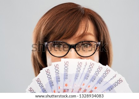 savings, finances and people concept - close up of senior woman holding five hundred euro money banknotes