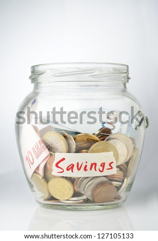 Savings jar full with coins