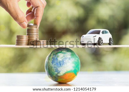 Savings money new car or insurance journey for vehicle Global coverage concept. Growing stacked of coins for car loan, car sponsorship / leasing credit and transport tax in the world of risk