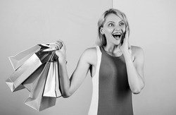 savings on purchases. happy woman shopper. big sale. female shopaholic hold shopping bags. present packages for holiday preparation. summer discount. special offer on black friday. shop closeout.