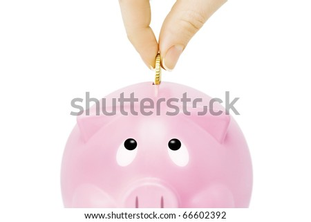 Savings -Piggy bank and hand with coin - stock photo